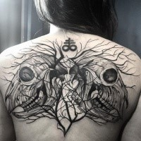 Blackwork style large upper back tattoo of mystical animal skulls with small symbols