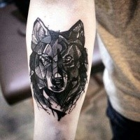 Blackwork style medium size forearm tattoo of wolf head