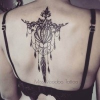 Blackwork style painted by Caro Voodoo upper back tattoo of floral ornament with feather