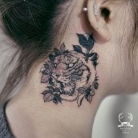Blackwork style painted by Zihwa neck tattoo of leopard with leaves