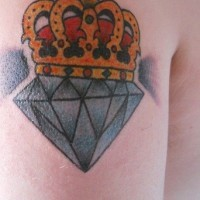 Blue diamond and yellow crown tattoo
