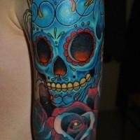 Blue mexican sugar skull tattoo on arm