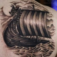 Boat of vikings tattoo on shoulder blade