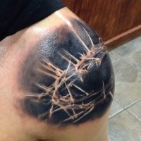 Breathtaking black and white Crown of thorns tattoo on shoulder