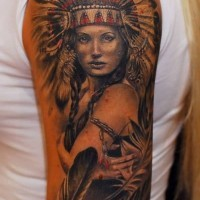 Breathtaking colored very detailed Indian woman portrait tattoo on shoulder with feather
