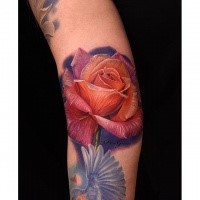 Breathtaking detailed arm tattoo of large rose with pigeon