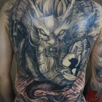 Breathtaking very detailed colored Asian evil dragon tattoo on whole back with Great Wall