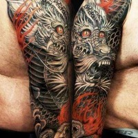 Breathtaking very detailed colorful dragon tattoo on sleeve with flames