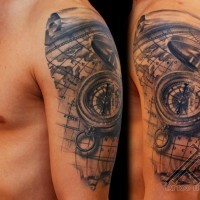 Breathtaking very realistic detailed nautical compass tattoo on shoulder