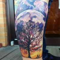 Brilliant designed and colored massive lonely tree with family and big moon tattoo on leg