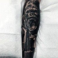 Brilliant detailed and colored angry Gorilla with city tattoo