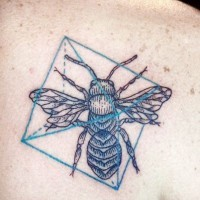 Bug and geometric symbols tattoo on shoulder blade