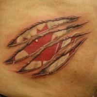 Canadian flag under skin rip tattoo
