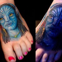 Carelessly painted and colored glowing foot tattoo of Avatar hero portrait