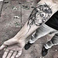 Carelessly painted by Inez Janiak forearm tattoo of lion head