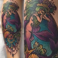 Carelessly painted colorful mermaid with flowers tattoo on leg muscle