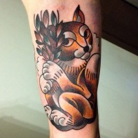 Cartoon ink colored squirrel tattoo on wrist