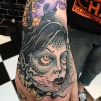 Cartoon like colored bloody vampire woman tattoo on hand