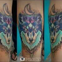 Cartoon like colored forearm tattoo of wolf head with moon