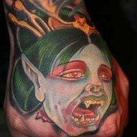 Cartoon like colored hand tattoo of vampire woman face