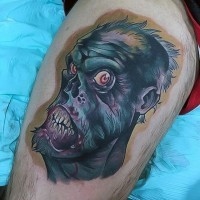 Cartoon like colored thigh tattoo of funny zombie face