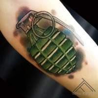 Cartoon like designed nice colored military grenade tattoo on arm