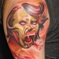 Cartoon like half zombie half vampire woman tattoo on shoulder