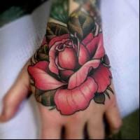 Cartoon like usual pink rose flower tattoo on hand