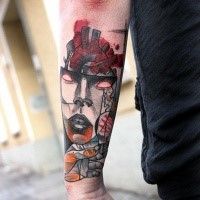 Cartoon style colored arm tattoo of demonic mask with bloody heart