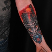 Cartoon style colored forearm tattoo of alien mask with city