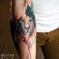 Cartoon style colored forearm tattoo of lion face with stars
