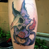 Cartoon style colored leg tattoo of funny dragon shaped monster