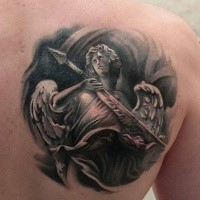 Cartoon style colored scapular tattoo of vintage angel warrior statue