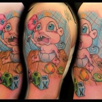 Cartoon style colored shoulder tattoo of funny little baby with cubes and toys