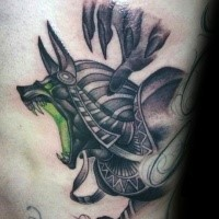 Cartoon style colored side tattoo of evil Egypt God
