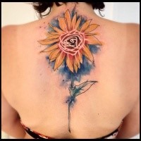 Cartoon style colored upper back tattoo of big flower