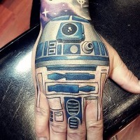 Cartoon style detailed colored Star Wars R2D2 droid tattoo on hand