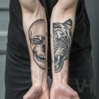 Cartoon style painted by Valentin Hirsch black ink forearms tattoo of split tiger head with human skull