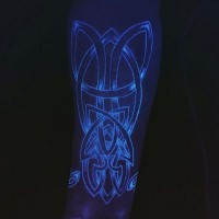 Celtic style big gloving ink painted tattoo on arm