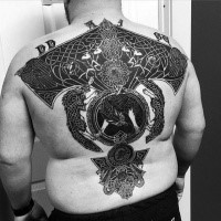 Celtic style black ink back tattoo of various ornaments