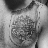 Celtic style black ink chest tattoo of medieval armor