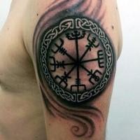Celtic style black ink shoulder tattoo of mystical symbol