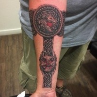 Celtic style colored forearm tattoo of big arm band with dragon