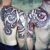 Celtic style colored shoulder and chest tattoo of various ornaments and lettering