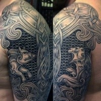 Celtic style colored shoulder armor tattoo stylized with various animals