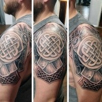 Celtic style colored shoulder tattoo of medium armor