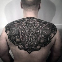 Celtic style colored upper back tattoo of big bull with various symbols