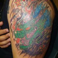 Chinese large dragon tattoo on arm