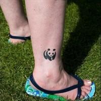 Chinese panda tattoo on leg