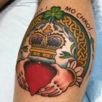 Circle shaped colored leg tattoo of Celtic symbols with heart with crown
